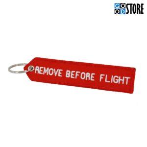 """Noolekujuline punane """"Remove Before Flight"""" võtmehoidja"""